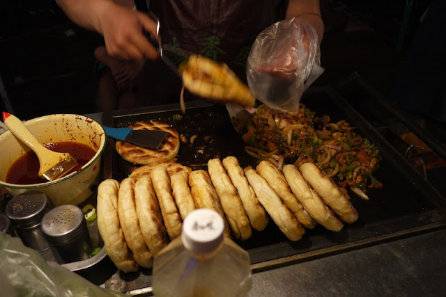 grilled meat and veggies in bread at Zhengning Street Night Market in Lanzhou, China