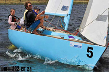 J/22 baby blue sailing in South African regatta