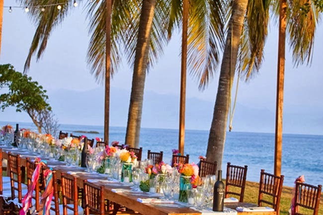 Long tables wedding reception beach