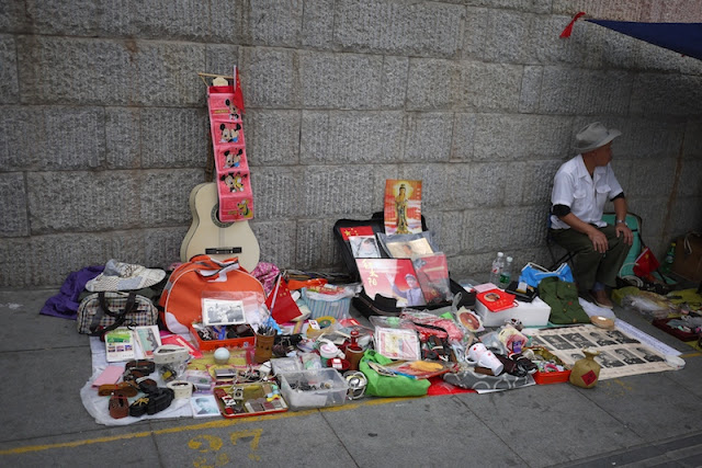 various items on the ground for sale outside Tianxinge Antique City in Changsha, China