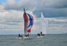 J/27 sailboats- sailing fast downwind on Lake Ontario