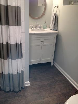 Wood looking tile for Looking for bathroom renovators