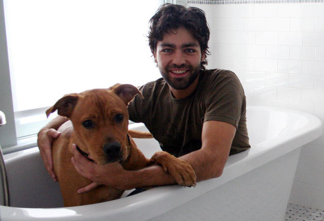 Adrien Grenier and a dog