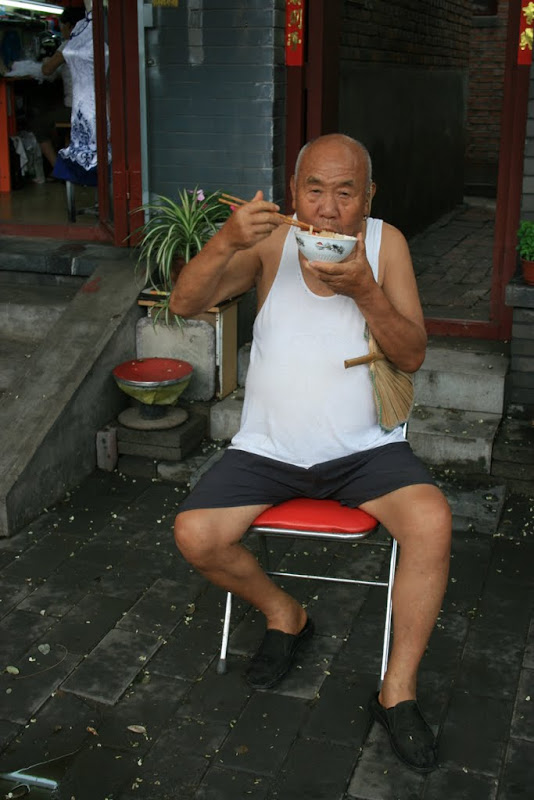 Chinese man eating noodles