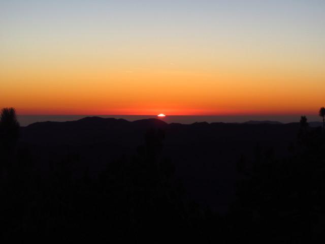 sun setting over the ocean from Reyes Peak