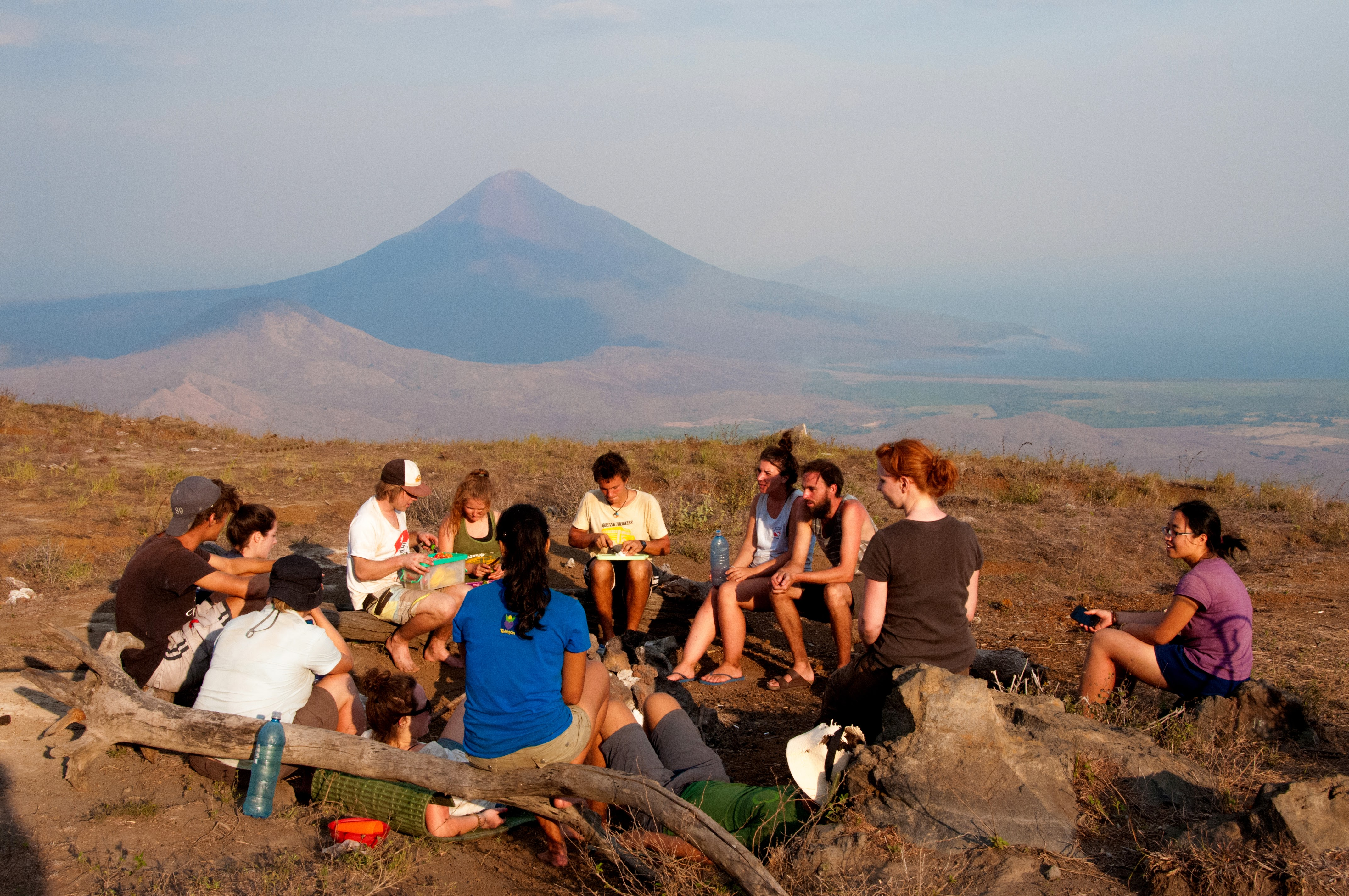 Sitting around campfire for dinner during El Hoyo Trek