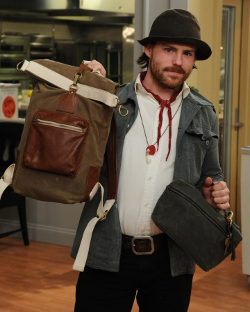 Tielor Mcbride holding a rugged tall roll-top sack in waxed twill and leather - http://www.etsy.com/shop/TM1985
