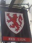 Red rampant Lion pub sign on white shield