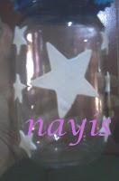 frasco de vidrio masa flexible decorado con estrellas