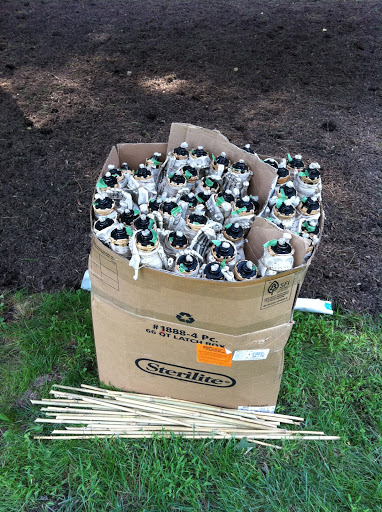Tiki torches all wrapped, filled and ready to go.