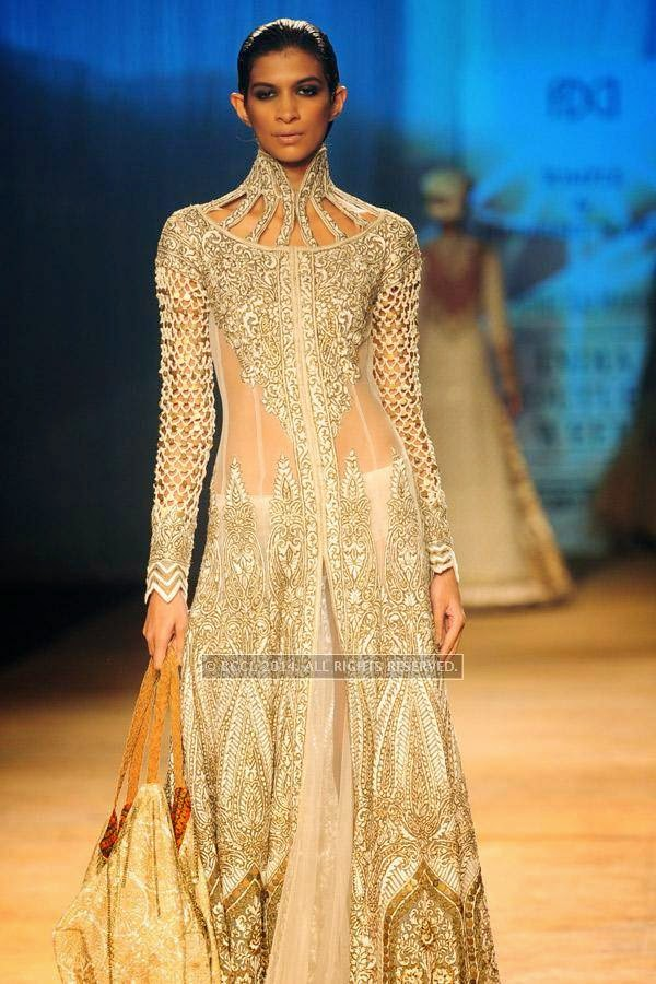 A model walks the ramp for Rimple and Harpreet on Day 6 of India Couture Week, 2014, held at Taj Palace hotel, New Delhi.<br /> <br />