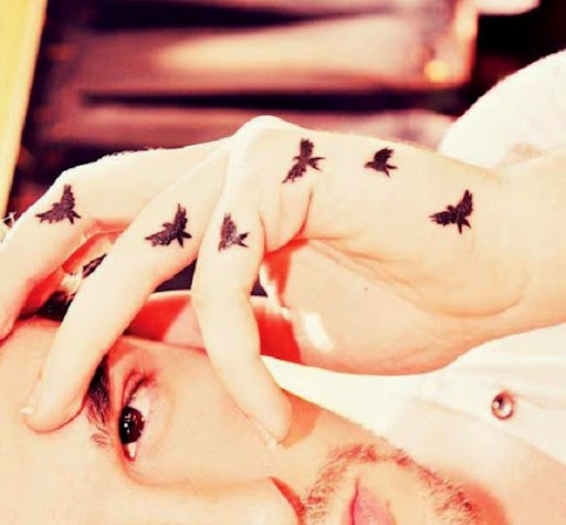 small flying birds tattoos on fingers