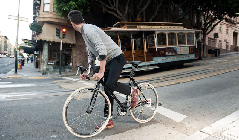 Black BTW bike near cable car