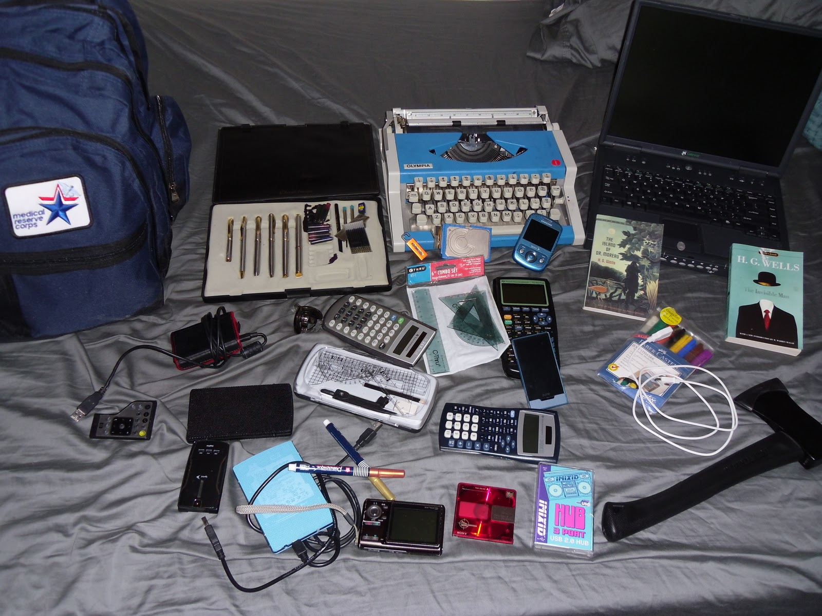 a picture of various objects including old technology and new technology. From books to mp3 players and pens to laptops