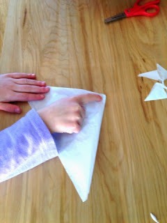 Making paper snow flakes is a classic winter activity that kids love.  Did you know it teaches math too?