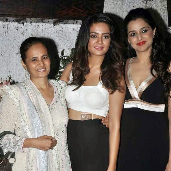 Surveen Chawla poses with her family at the premiere of Bollywood movie Hate Story 2, held at Super Sunny Sound in Mumbai, on July 17, 2014.(Pic: Viral Bhayani)