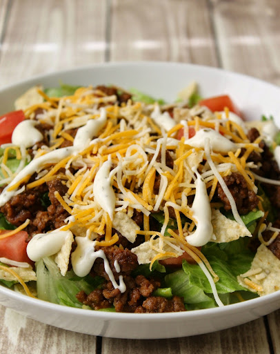 This Quick & Easy Taco Salad recipe has all the yummy flavors of a taco on one plate. No big shell needed, just add a few crushed tortilla chips to give you that nice crunch.