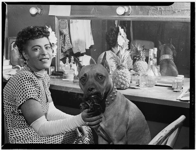 Billie Holiday and Mister in her dressing room