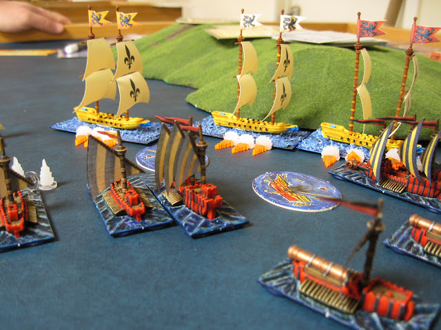 Next turn sees the Corsairs send the lead Wolf Ship to the briny deep and damage another taking out its oars.