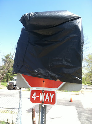 covered stop sign garbage bag 4way stock photo