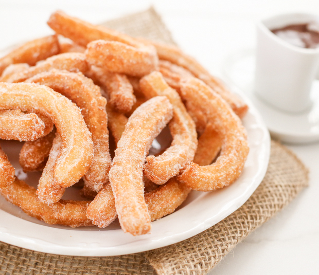 close-up photo of a plate of churros