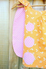 Made with Moxie:Roly-Poly Pinafore pattern review. Denise Schmidt orange fabric side.