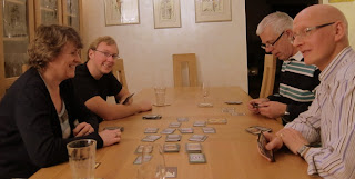 The players during a game of Dominion