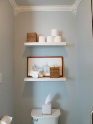 Lovely Powder blue fits this powder room even the stack of white toilet paper looks like a cloud From Tell uer All About It via DIY Showoff