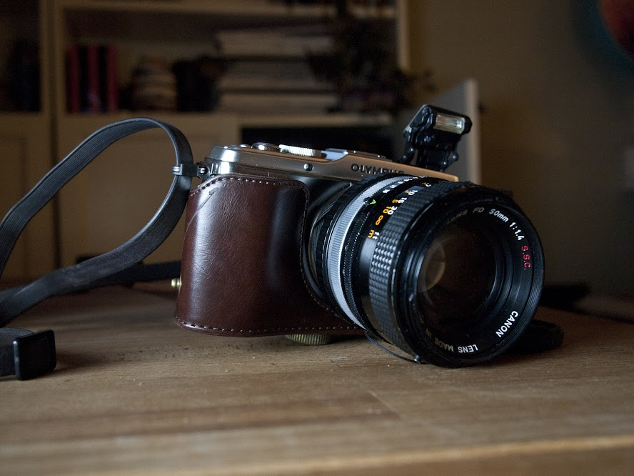 Olympus E-P3 with  Canon FD 50mm f1.4 S.S.C and a leather half-case (taken with my E-P1 with  Panasonic 20mm f1.7)
