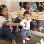 Infants at Parent & Child classes get a chance to pull up on grab bars when they are ready to stand up all by themselves.