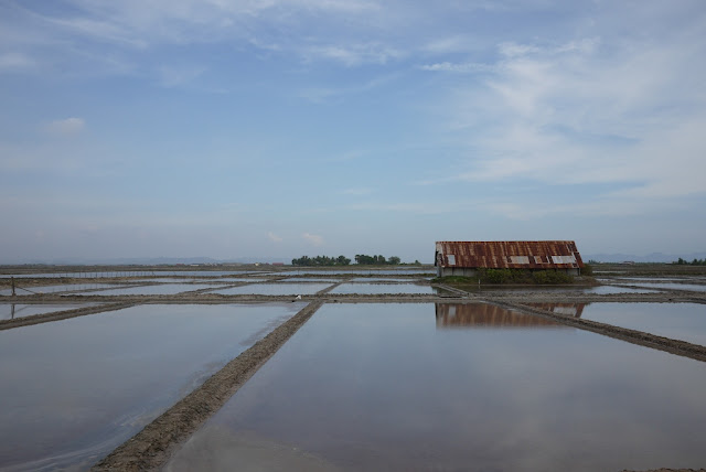 a building in the salt fields