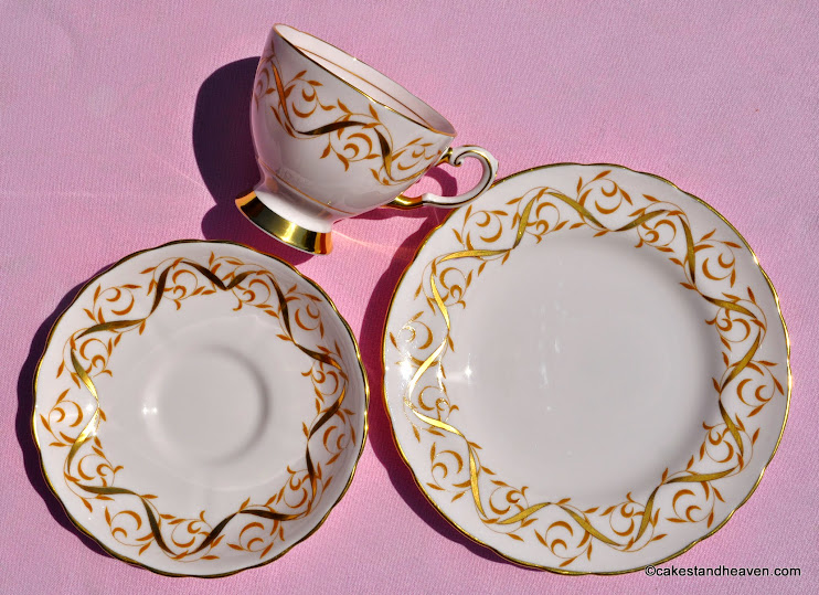 Tuscan china teacup trio decorated with gold