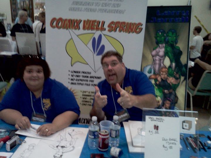 Larry Jarrell of What The Flux Comics ?! And Wife at the PalmCon.