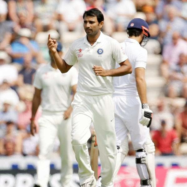 India's Mohammad Shami celebrates taking the wicket of England's Sam Robson during the first day of the third cricket test match of the series between England and India at The Ageas Bowl in Southampton, England, Sunday, July 27, 2014.