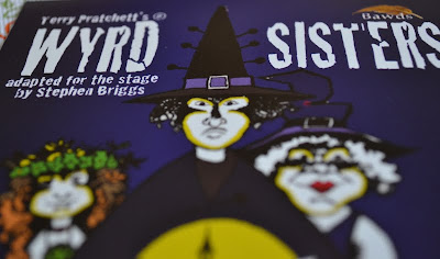 Flyer of Wyrd Sisters on stage