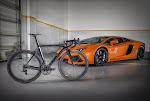Divo ST Campagnolo Super Record 80th Anniversary Complete Bike with a Lamborghini Aventador at twohubs.com