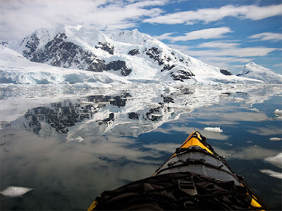 View from a kayak heading through icy waters in Antarctica