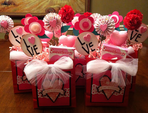 i made these centerpieces for a seniors valentines day luncheon i used small red bags decorated the front put floral foam base made handmade flowers - Valentines Day Centerpieces