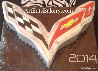 Custom unique silver, black, red and yellow 3D Corvette emblem cake design
