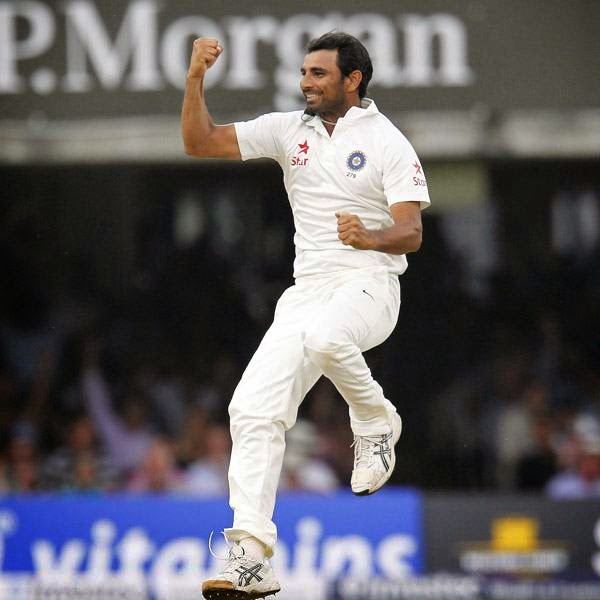 India's Mohammed Shami celebrates taking the wicket of England's Gary Ballance for 27 runs during play on the fourth day of the second cricket Test match between England and India at Lord's cricket ground in London on July 20, 2014.