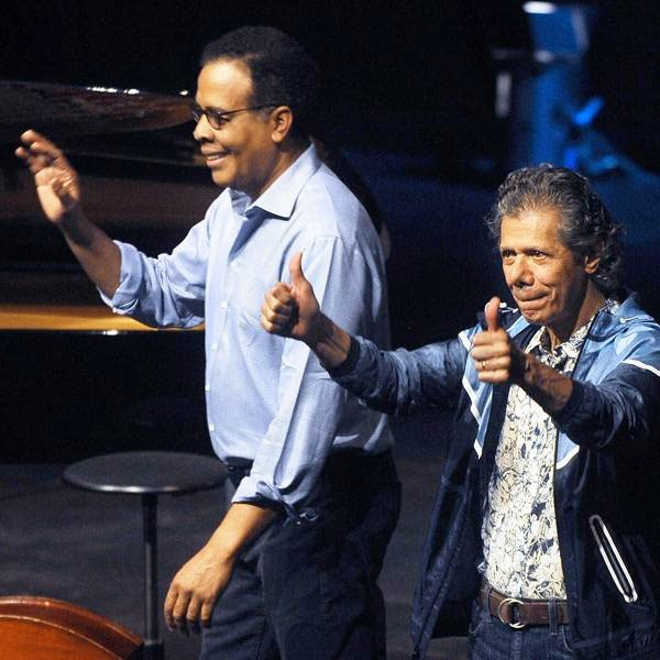 US musicians Chick Corea (R) and Stanley Clarke (L) acknowledge the crowd during the third day of the 49th Jazzaldia Jazz festival of San Sebastian, north of Spain, on July 23, 2014.