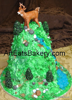 Custom handcrafted deer sugar sculpture on butter cream Groom's cake mountain
