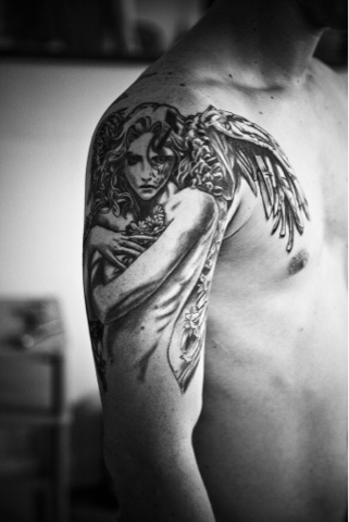 See more Scared angle with wings tattoos on shoulder and arm