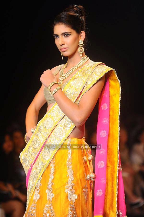 A model walks the ramp for Saboo Fine Jewels on Day 3 of India International Jewellery Week (IIJW), 2014, held at Grand Hyatt, in Mumbai.<br />