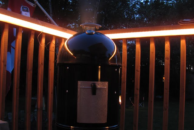 Weber Smokey Mountain Cooker at Night