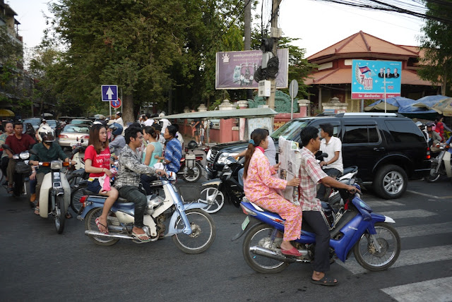 motorbikes at a crowded interestion in Phnom Penh