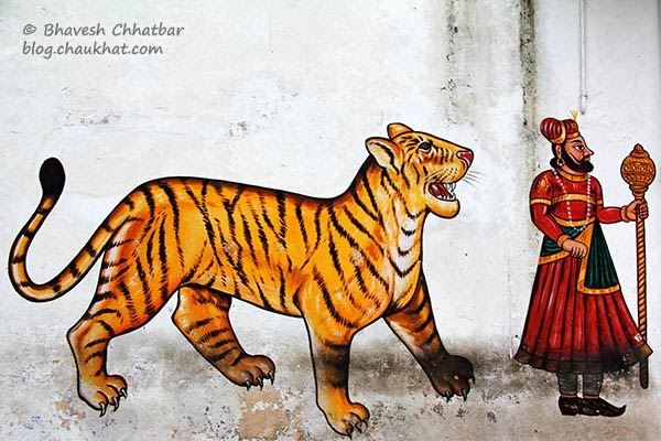 Wall painting of a tiger and a guard