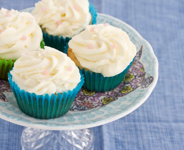 photo of four cupcakes on a cake stand