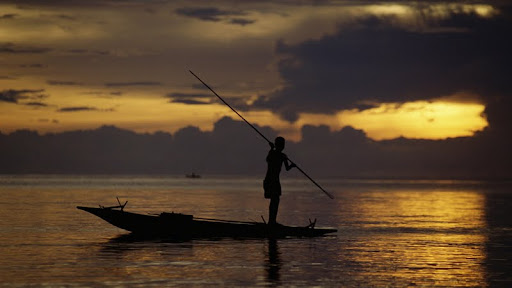 Fisherman at Sunset, Fergusson's Island, Papua New Guinea.jpg