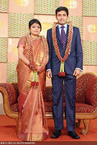 Singer Sudha Raghunathan's son Kaushik and Urmitapa pose for cameras during their wedding ceremony, held in Chennai.